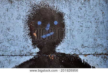 abstract face on cement background wall, painting