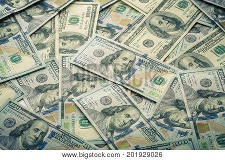 Lot of one hundred dollar bills close-up background. Bank. Business. Casino. Wages. Pattern poster