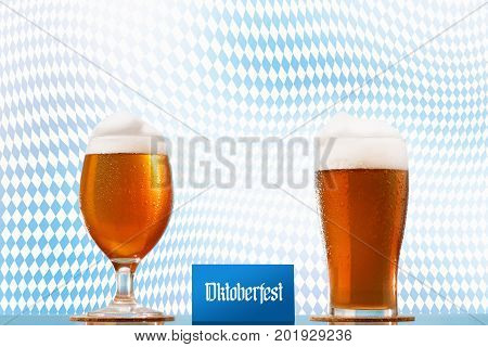 Oktoberfest Beer glass pint on Bavarian flag background with foam and festival text. Design concept.