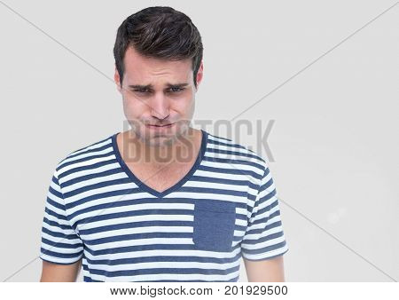 Digital composite of Portrait of Man feeling sick like vomiting with grey background