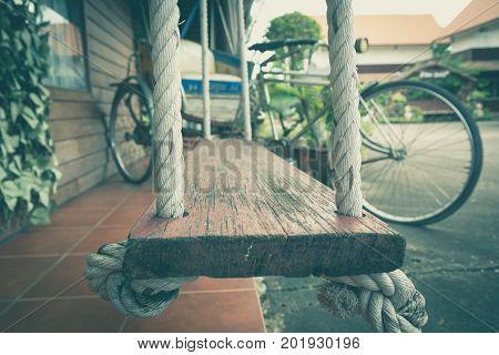 Empty chain swing in playground. Image of children swing.