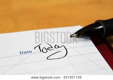 A Closeup Of The Notepad With A Pen Tip And The Words Today Written For The Date
