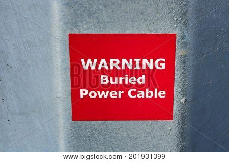 Warning Buried Power Cable Sign On Metal Pole