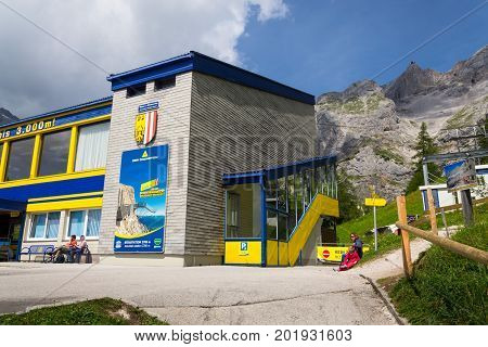 Ramsau Am Dachstein, Austria - August 17: Tourists In Front Of The Lower Station Of The Dachstein Ca