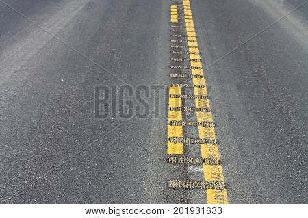 Closeup View Of Center Rumble Strips On A Highway
