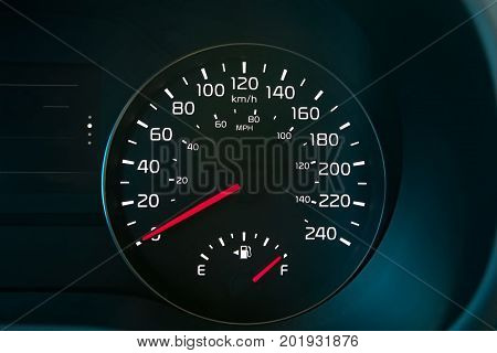 A Speedometer Showing A Full Fuel Tank