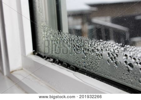 Water condensation on windows during winter causing damage