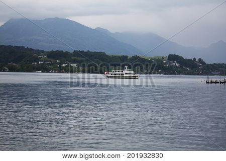 Swiss Landscape with lake and boat in Luzern