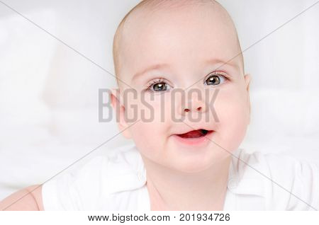 Happy Smiling Child With Wide Open Brown Eyes