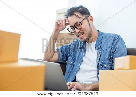 Young Asian Man Unsuccess For Work About Online Business Or Sme , Young Owner Man In Stress Situatio