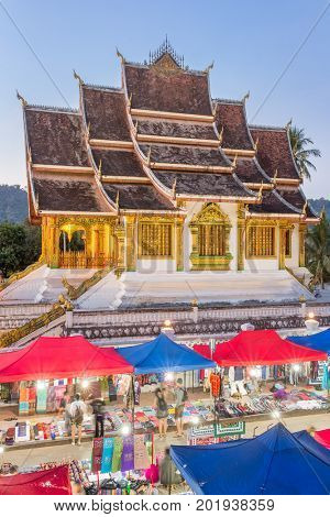 Famous night market and the Haw Pha Bang temple in Luang Prabang, inside the Royal Palace complex, in Laos