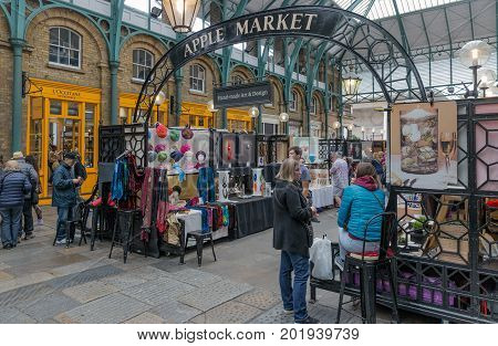 LONDON ENGLAND - JUNE 08 2017: Covent Garden market in London. This tourist attraction in London is famous about its restaurants pubs market stalls and shops.