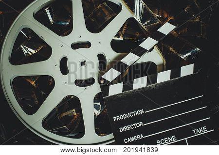 Vintage Movie Background, Reel Filmstrip And Clapper Board