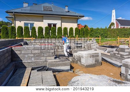 Brick up concrete blocks for foundation of a house