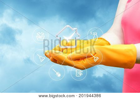 Worker in the hands of the service is cleaning the house. A concept design.