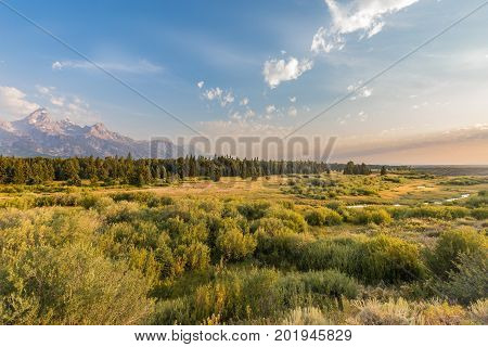 a scenic vista of the Teton Range landscape in Wyoming