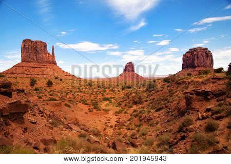 Monument Valley is a region of the Colorado Plateau characterized by a cluster of vast sandstone buttes.