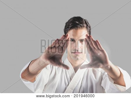 Digital composite of Portrait of martial arts Man with grey background