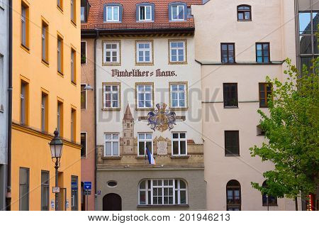 Munich, Germany - May 02, 2017: The fasade of old residential house at Munich in Bavaria, Germany on May 02, 2017
