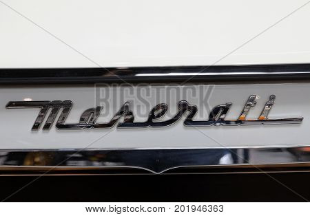 CRACOW POLAND - MAY 20 2017: Maserati metallic logo closeup on Maserati car displayed at 3rd edition of MOTO SHOW in Cracow Poland. Exhibitors present most interesting aspects of the automotive industry