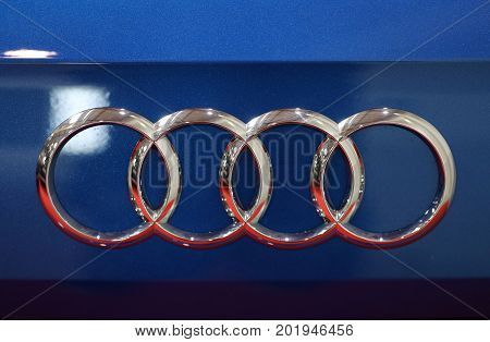 CRACOW POLAND - MAY 20 2017: Audi metallic logo closeup on Audi car displayed at 3rd edition of MOTO SHOW in Cracow Poland. Exhibitors present most interesting aspects of the automotive industry