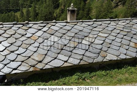 Detail of weathered slate roof. Northern Italy.