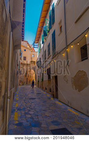 PALMA DE MALLORCA, SPAIN - AUGUST 18 2017: Unidentified woman walking in the streets in old city of Palma de Mallorca, Spain.
