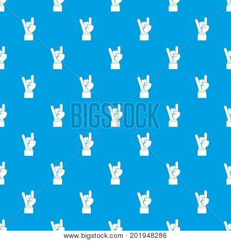 Rock and Roll hand sign pattern repeat seamless in blue color for any design. Vector geometric illustration