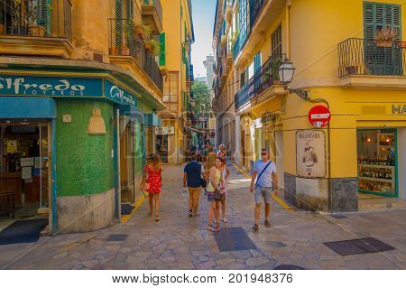 PALMA DE MALLORCA, SPAIN - AUGUST 18 2017: Unidentified people walking and buying in the streets in old city of Palma de Mallorca, Spain.