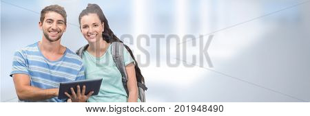 Digital composite of Students on tablet in front of blurred background