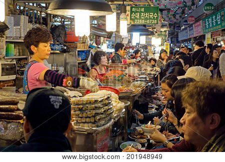 Seoul, South Korea - April 08, 2017: Woman Vendor Serving Customers At Gwangjang Market In Seoul. It