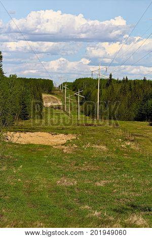 A wide cut line through rural farmland.