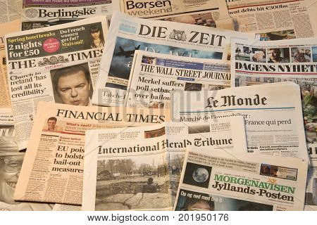World newspapers in pile detail of newspapers with news information and reading. Copenhagen, August 29, 2017