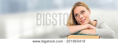 Digital composite of Student leaning on books in front of blurred background
