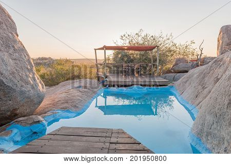 HOADA NAMIBIA - JUNE 27 2017: A swimming pool hidden between boulders on a hill at the Hoada Camp in the Kunene Region of Namibia