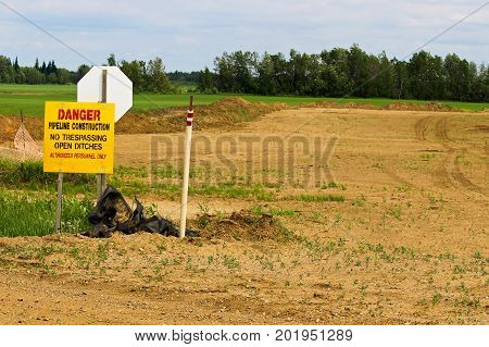 Danger Pipeline Construction Sign With No Trespassing