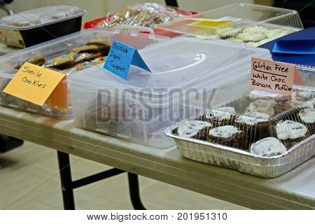 Items Set Up On A Table At A Bake Sale