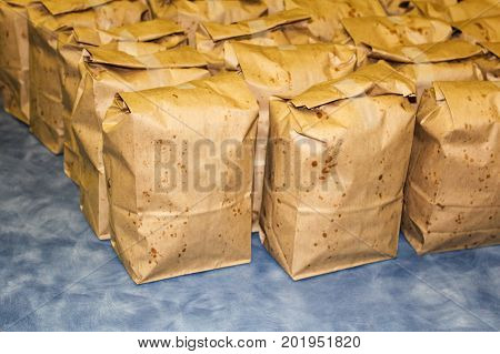 Brown Bags Filled With Popcorn Ready For Fundraiser Sale