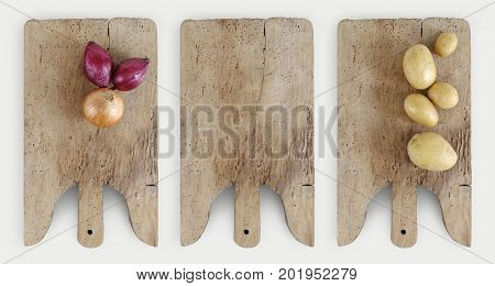 Concept of cooking with wooden cutting board onion and potatoes isolated on kitchen white worktop copy space top view