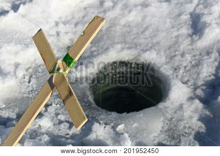 A homemade ice fishing tip up using wood