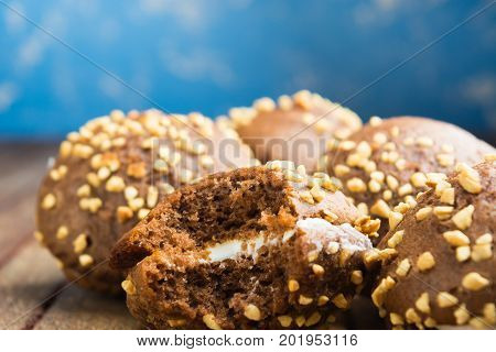 Chocolate Cookies With Whipped Cream And Nuts On Blue Background