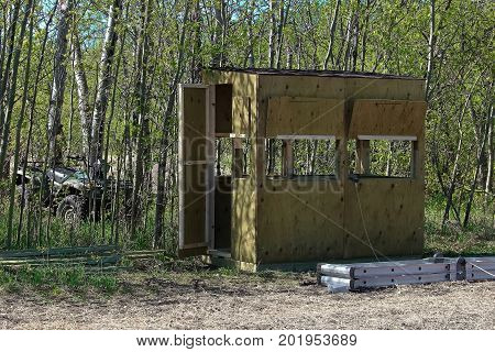 A hunting blind being assembled on the ground