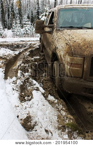 A front view of a vehicle stuck in the mud.