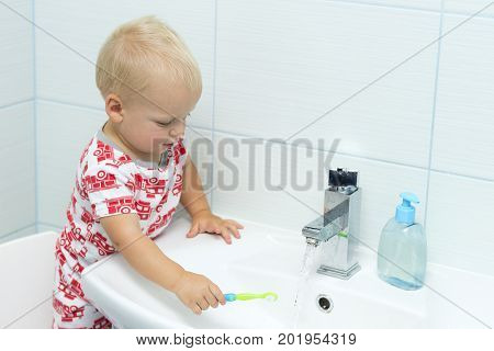 Cute Toddler Boy Brushing Teeth. Teeth Cleaning, Dental Care. Adorable Baby Boy Washing Up