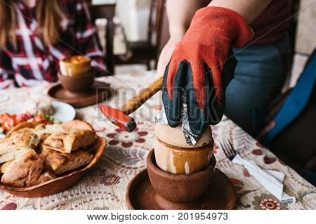 The national Turkish dish in the pot that is broken before use is called Testi-kebab. The cook breaks the pot with a hammer before serving the restaurant visitor. National dish of Turkey.