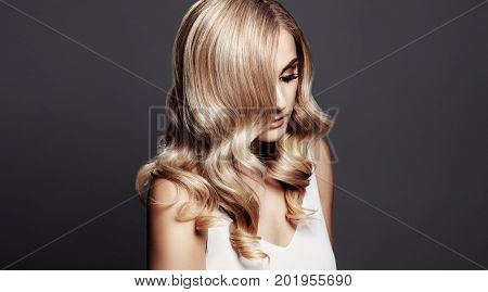 Elegant Woman With Shiny Wavy Blond Hair