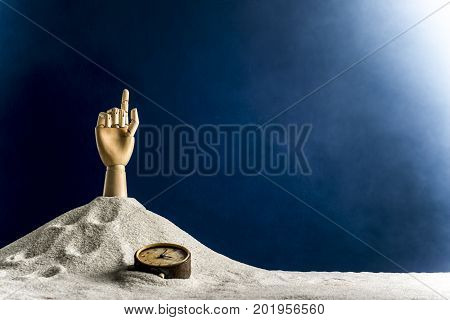 Wooden hand of a man gesticulating against a blue background