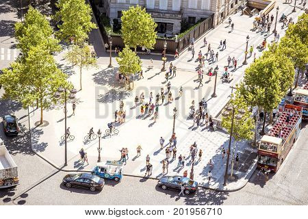 PARIS, FRANCE - August 07, 2017: Top view on the place Charles de Gaulle with cars and people. This round is the meeting point of twelve straight avenues in Paris