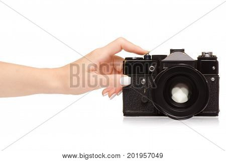 Female hand holding a camera on a white background isolation