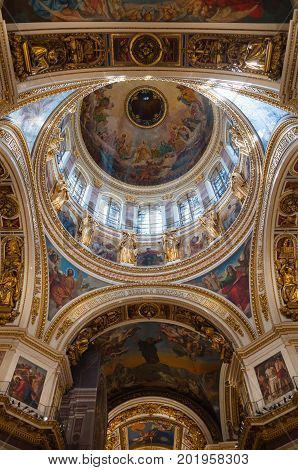 ST PETERSBURG RUSSIA - AUGUST 15 2017. Ceiling with sculptures and Bible paintings in the interior of the St Isaac Cathedral in St Petersburg Russia